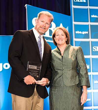 John Stonecipher of Guidance Aviation winning the SBA National Person of the Year award in Washington DC
