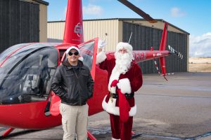 Guidance Aviation Pilot Zach Hardwick with Santa Claus and a Robinson R66